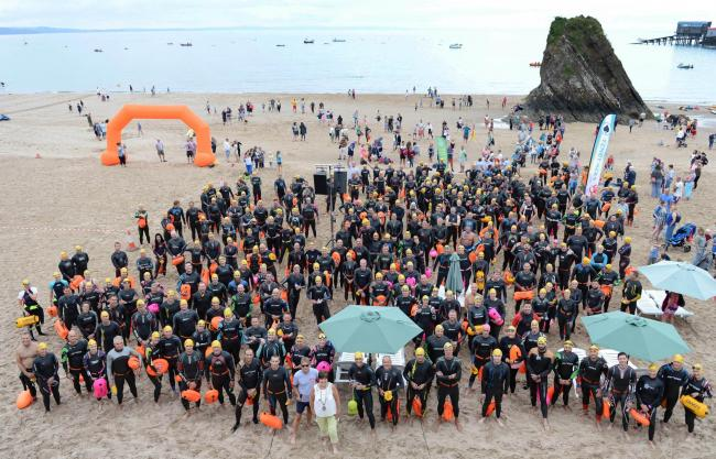 The scene on Tenby's North Beach at last year's TenFoot weekend before the event's swimmers set off for Saundersfoot. PICTURE: Gareth Davies Photography