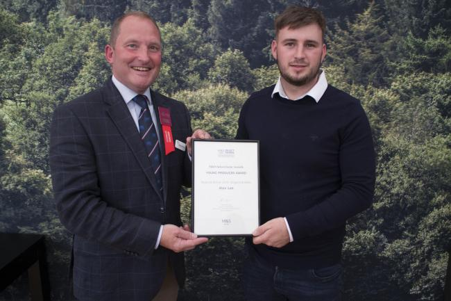Steve McLean, head of agriculture and fisheries at M&S, present Alex Lee with his award