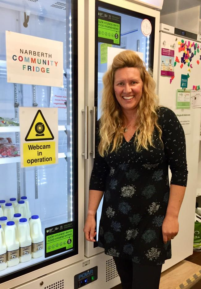 Narberth Community Fridge co-ordinator, Vicki Travers-Milne, is pictured with the webcam-enabled chiller.