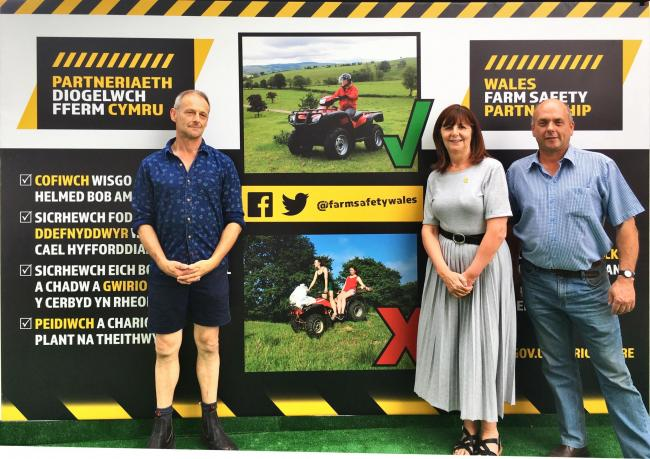 Farm safety ambassadors Alun Elidyr Edwards (left) and Glyn Davies (right) with Minister Lesley Griffiths