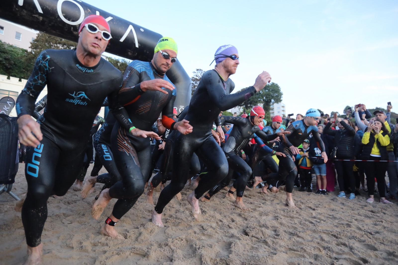 Thousands in Tenby as Ironman Wales athletes dive in to swim