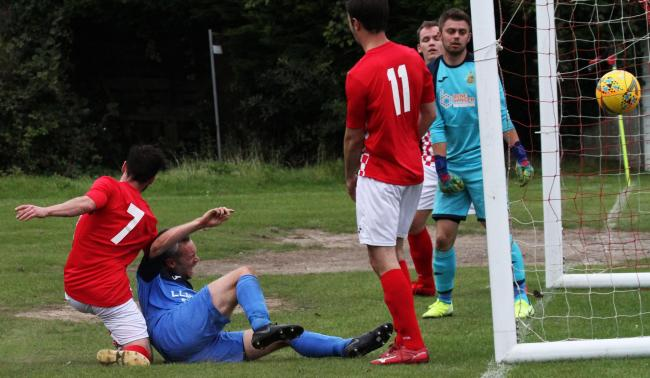 Dan Scourfield drills in Monkton's second goals at Saundersfoot. PICTURE: Susan McKehon