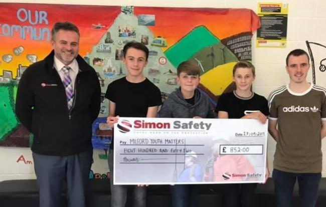 Simon Safety Managing Director Simon Ashton is pictured presenting the cheque for £852 to Milford Youth Matters.