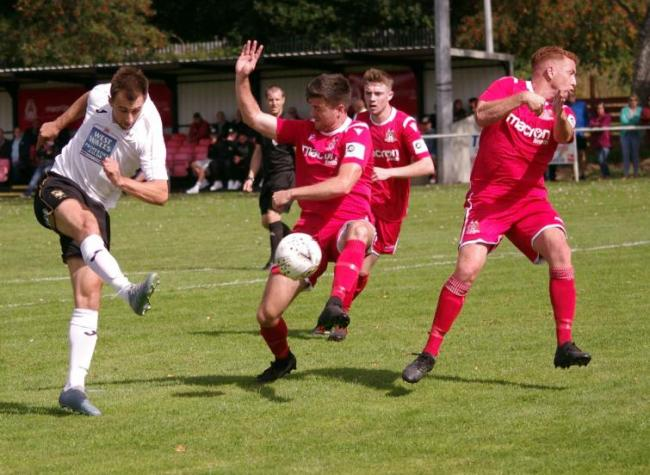 Marcus Griffiths in action at Briton Ferry Llansawel earlier in season - the striker scored a late winner on Saturday.
