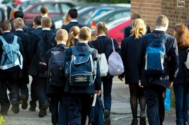 Pupils who use school buses to attend school outside of their catchment area will have to pay £2 a day.