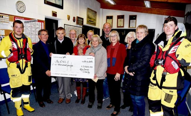 CHECK THIS Reg's sister and brother-in-law Hazel and Richard James along with members of the Clwb Cinio present a cheque for £2,000 to Fishguard RNLI fundraisers and crew.