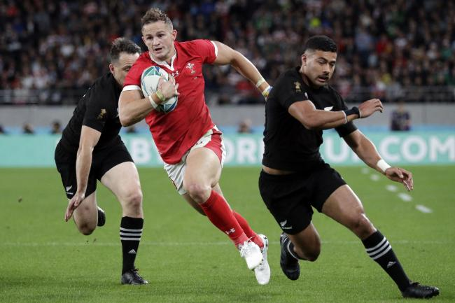 Wales' Hallam Amos runs to score a try during the Rugby World Cup bronze final game at Tokyo Stadium between New Zealand and Wales in Tokyo, Japan, Friday, Nov. 1, 2019. (AP Photo/Aaron Favila).