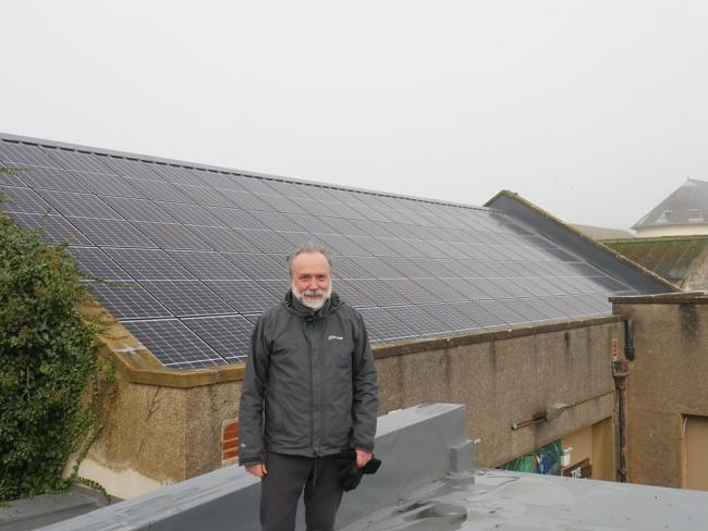 Jerry Evans in front of the new Haverhub solar panels. PICTURE: Western Telegraph