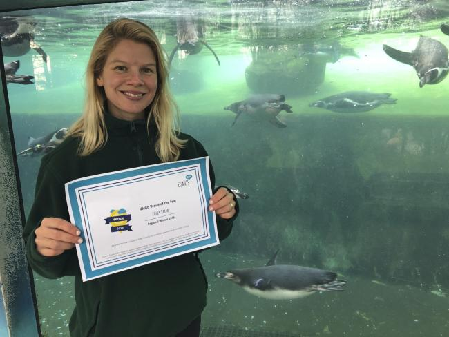 Folly Farm zookeeper Caroline Davies is pictured with the attraction's Welsh award.
