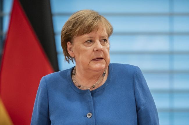Image result for Coronavirus: First virus test negative for quarantined German Chancellor Angela Merkel