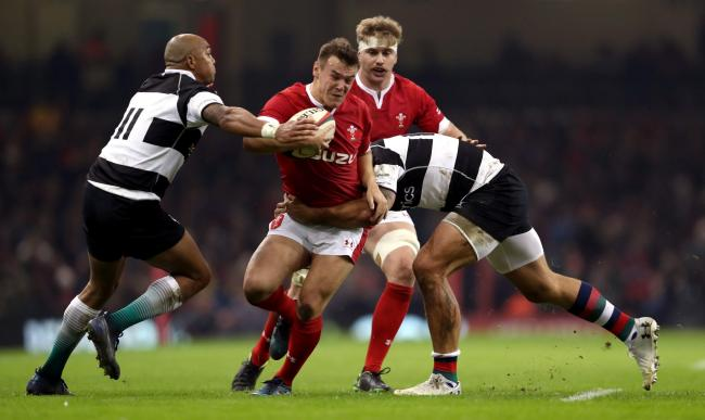 PLAYMAKER: Jarrod Evans on the run for Wales against the Barbarians