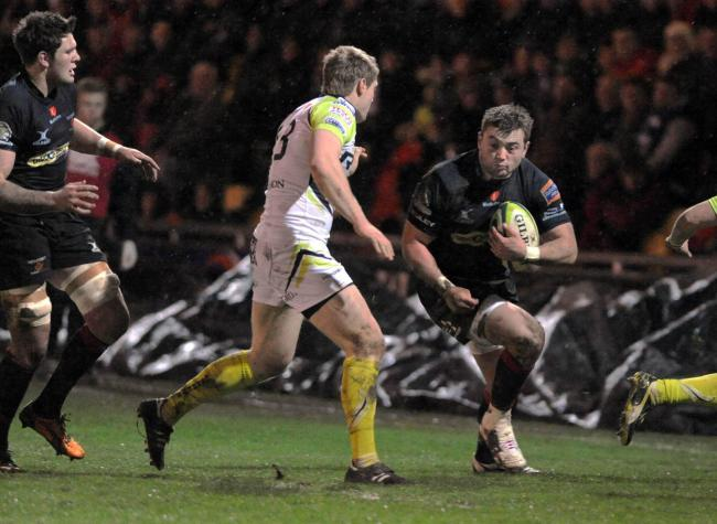 SWA MIKE LEWIS 26 1 13 REPORTER..DRAGONS V OSPREYS..DRAGON'S PLAYER SAM PARRY ON THE ATTACK AGAINST THE OSPREYS.