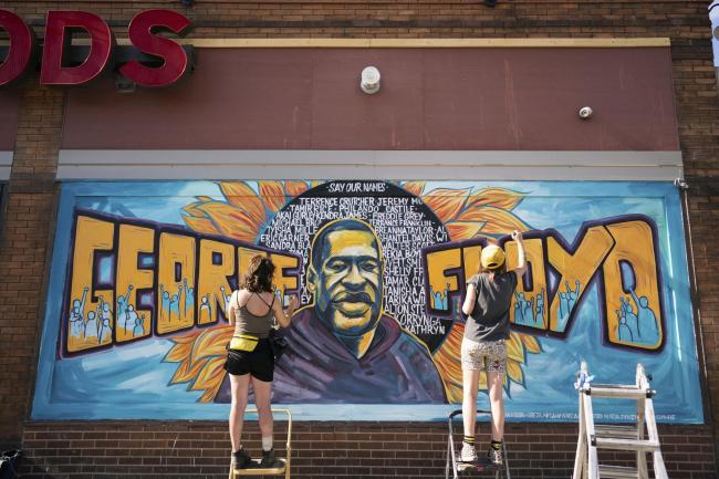 Artists complete a mural of George Floyd outside of Cup Foods, Thursday, May 28, 2020 in Minneapolis/ Minnesotans took to the streets in a third day of protests following the death of George Floyd at the hand of Minneapolis police officers. (Mark Vancleav