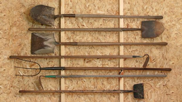 Western Telegraph: Get heavy tools, rakes, shovels, etc., off the floor using utility hooks or, even, nails. Credit: Getty Images / Twoellis