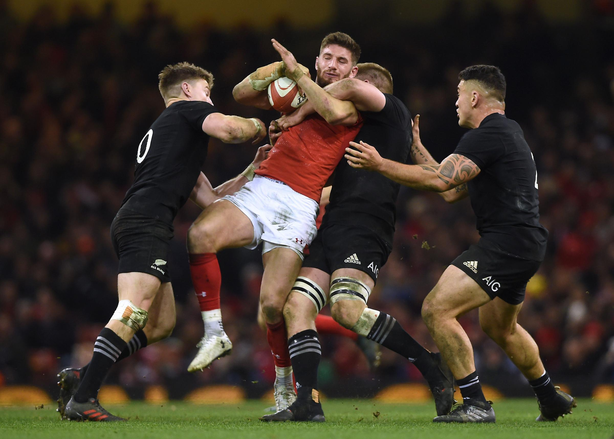 Wales Owen Williams is tackled by New Zealands Beauden Barrett, Sam Cane and Codie Taylor during the Autumn International at the Principality Stadium, Cardiff. PRESS ASSOCIATION Photo. Picture date: Saturday November 25, 2017. See PA story RUGBYU
