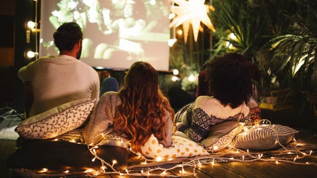 Western Telegraph: Sit back and relax with a projector and outdoor screen. Credit: Getty Images / M_A_Y_A