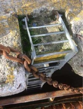 Western Telegraph: The previous ladder used at the port obstructed by chains. Picture: Febima