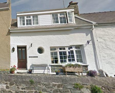 A planning report says that the heavily altered cottage 'does not contribute positively to the character and appearance of the Solva Conservation Area'. Picture: Google Maps