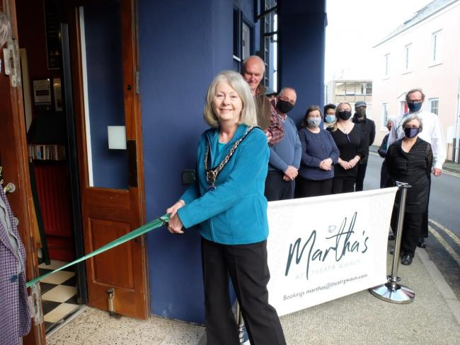 Fishguard mayor, Jackie Stokes, cuts the ribbon at the official opening of Martha's at Theatr Gwaun