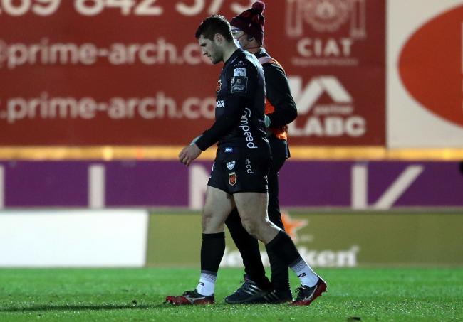 OFF: Dragons full-back Jonah Holmes suffered a head injury against the Scarlets