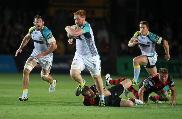 Western Telegraph: STRONG RUNNER: Dan Baker on the charge for the Ospreys against the Dragons