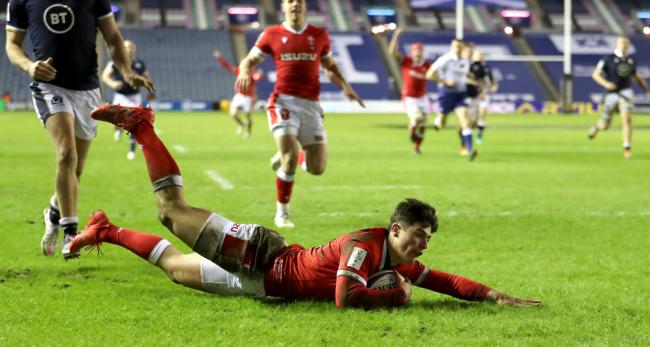 Wales' Louis Rees-Zammit dives in to score his sides fourth try during the Guinness Six Nations match at BT Murrayfield Stadium, Edinburgh. Picture date: Saturday February 13, 2021..