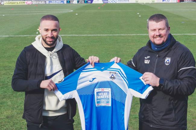 Jazz Richards with Haverfordwest manager Wayne Jones. Pic: Haverfordwest County AFC