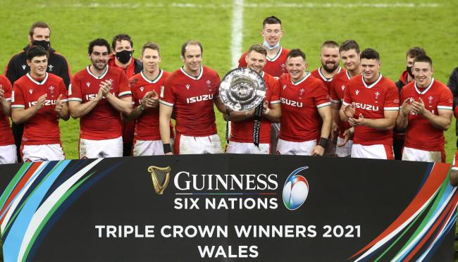 Wales celebrate winning the Triple Crown after their Six Nations win against England