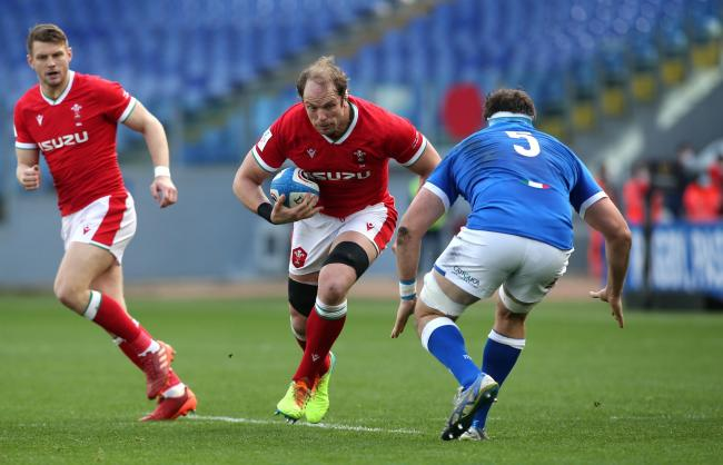 Wales' Alun Wyn Jones (left) runs at Italy's David Sisi (right) during the Guinness Six Nations match at Stadio Olimpico, Rome. Picture date: Saturday March 13, 2021.