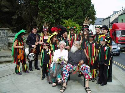 The bride and groom (seated) with members of Heb Enw border morris who made a surprise appearance at their wedding