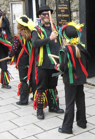 The morris dancers of Heb Enw at the official opening of the 2011 Fishguard Folk Festival outside the Royal Oak pub in the centre of town.
