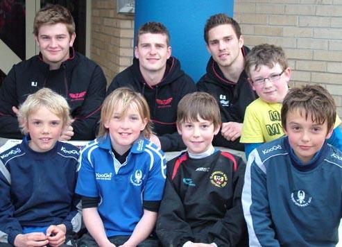 Young rugby fans pose with Scarlets rugby stars at Haverfordwest RFC