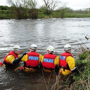 Western Telegraph: A specialist police search team searches the River Wear after an eight-year-old boy fell into the swollen river