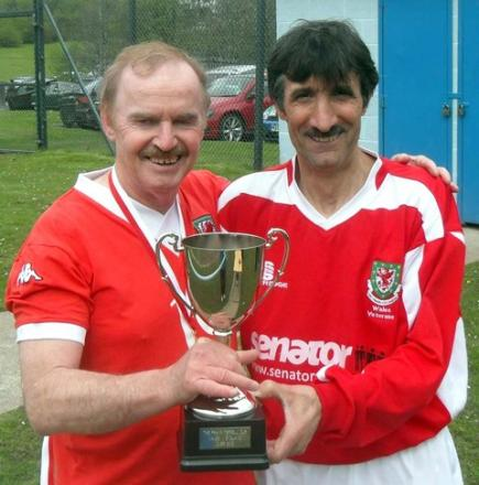 Wales over 60 footballers Bob Nelson and Mick Algieri pose with Frank Terrell Trophy.