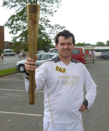 Rhys Eynon carries Olympic Torch with pride. Picture: Bill Carne