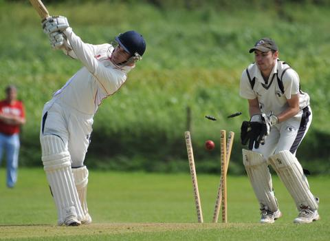 Carew's Martin Scourfield is clean bowled in top of table clash with Neyland.	Picture: Ian Miller.