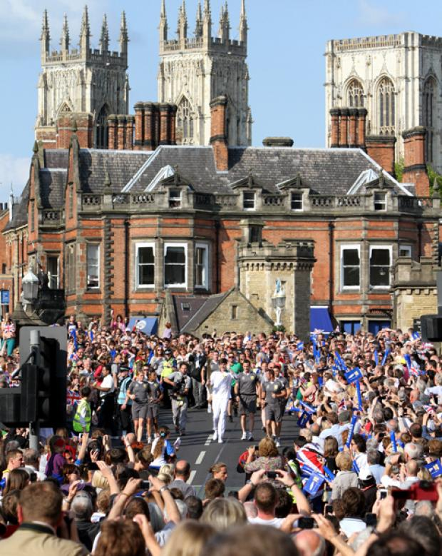 Western Telegraph: The Olympic torch comes over Lendal Bridge .