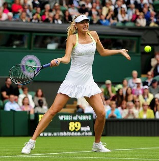 Maria Sharapova is through to the second round at Wimbledon