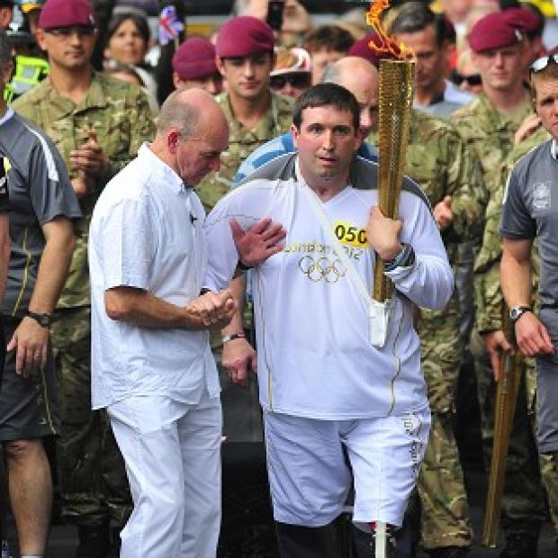 Ben Parkinson, the most seriously wounded soldier to survive the war in Afghanistan, carries the Olympic Flame through Doncaster (Locog/PA)