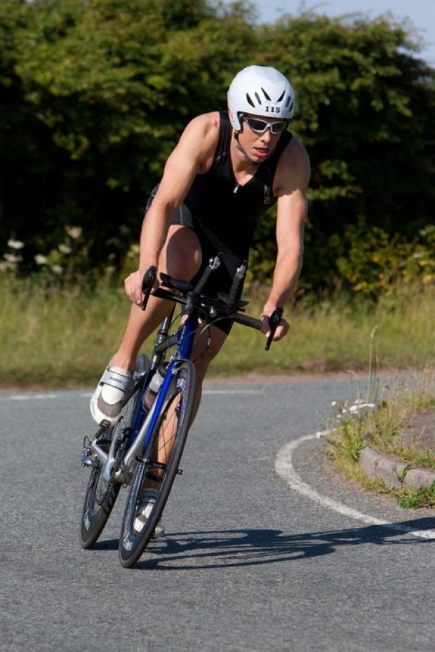 2011 race winner Oliver Simon tackles the challenging bike course. Picture: www.drewbuckleyphotography.com