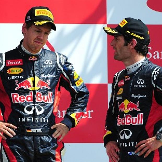 Sebastian Vettel (left) and Mark Webber face an anxious wait ahead of the German Grand Prix