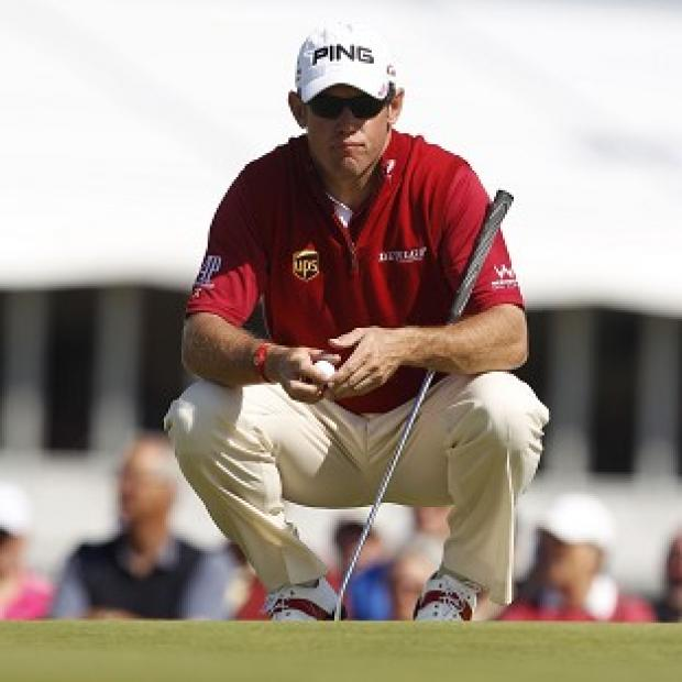Lee Westwood lines up a putt during day four of the Open