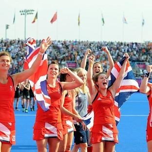 Team GB celebrate winning a bronze medal courtesy of a 3-1 victory over New Zealand