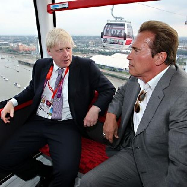 Mayor Boris Johnson and Arnold Schwarzenegger take a ride on the Emirates cable car from Greenwich to the ExCeL in Docklands