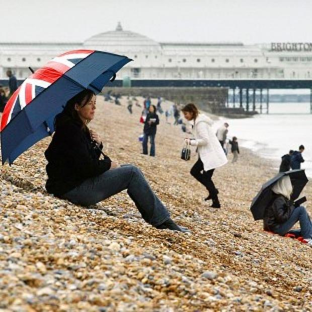 Wet and windy weather will dash hopes of a glorious Bank Holiday weekend, forecasters said