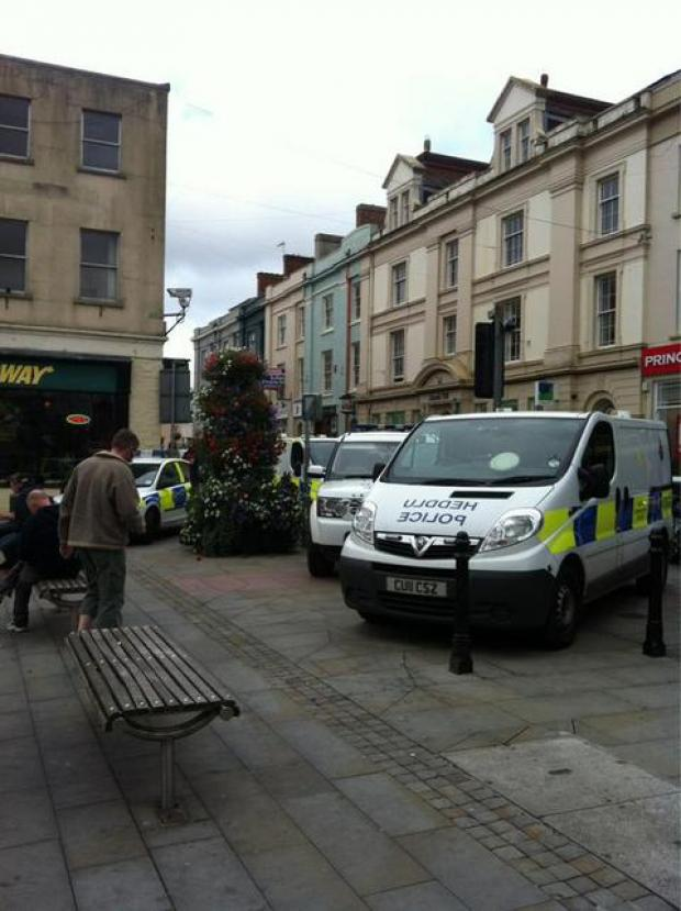 "Police have confirmed that they are at an incident in Haverfordwest town centre concerning an ""agitated and threatening"" man. Pic via@kateosaurusrex"