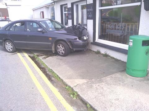 The occupants of this car were lucky to escape without injuries after hitting the Sands Cafe, Newgale PICTURE: Bruce Sanderson