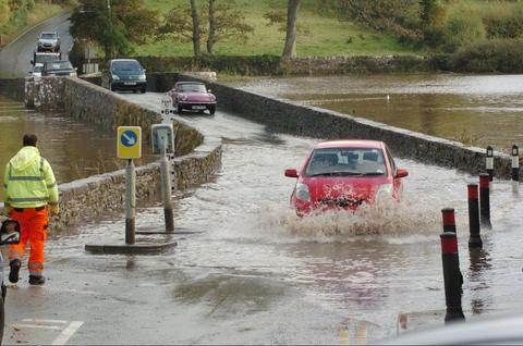 Cars negotiate the flooded Carew bridge PIC: Martin Cavaney Photography