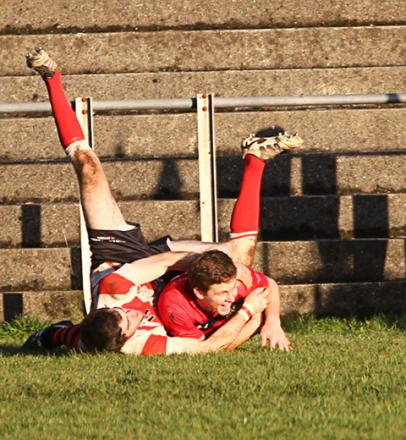 Greg Caine holds off a defender to score Tenby's first try at Heywood Lane. Picture Dave Bolton.