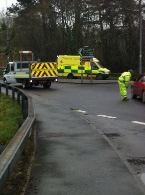 An ambulance heads through the closed Scotchwell Roundabout.